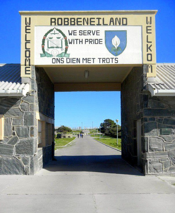 Ready to enter Robben Island Prison – where Nelson Mandela spent 18 years (The motto over the gate (We Serve With Pride) is just too weird!)