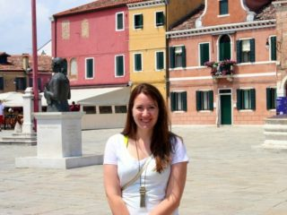 Katie on the island of Burano in Venice, Italy, in front of the lace museum.