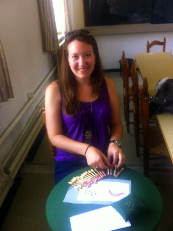 Katie making a piece of lace in the classroom in Bruges.