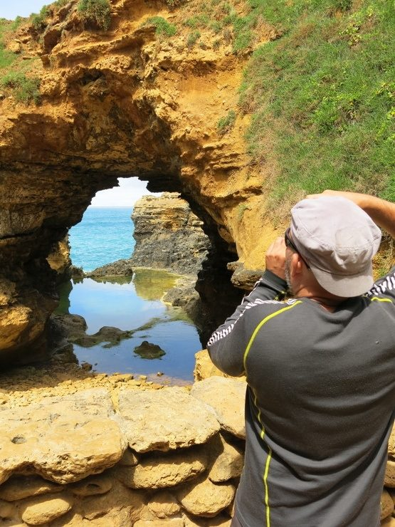 Ryan photographing a grotto in Australia. (Ryan is the master photographer in their traveling relationship.)