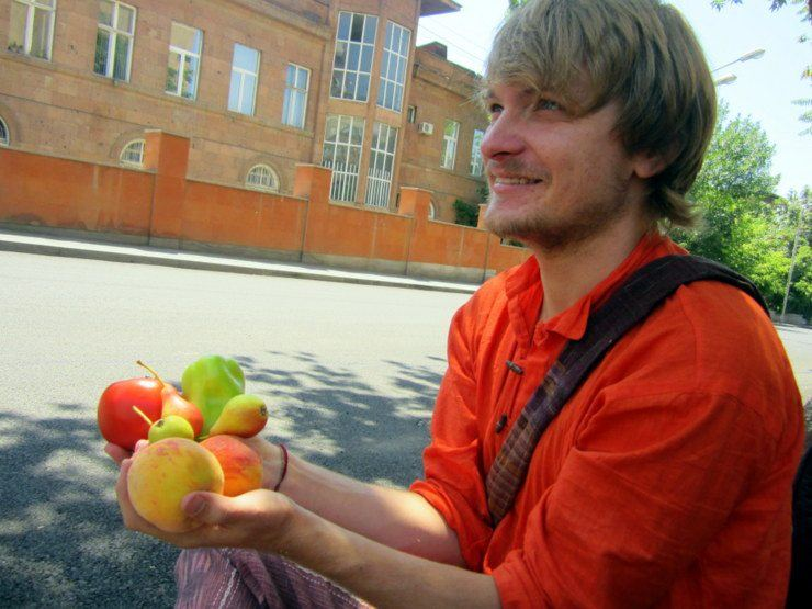 Eric being given free fruit in Armenia.