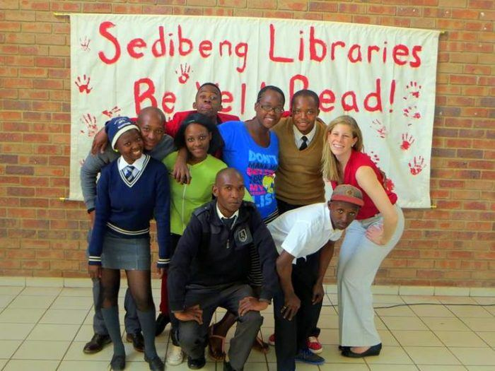 Mica with students from her after school program (Club Empower) in South Africa at the official launch of the college libraries.