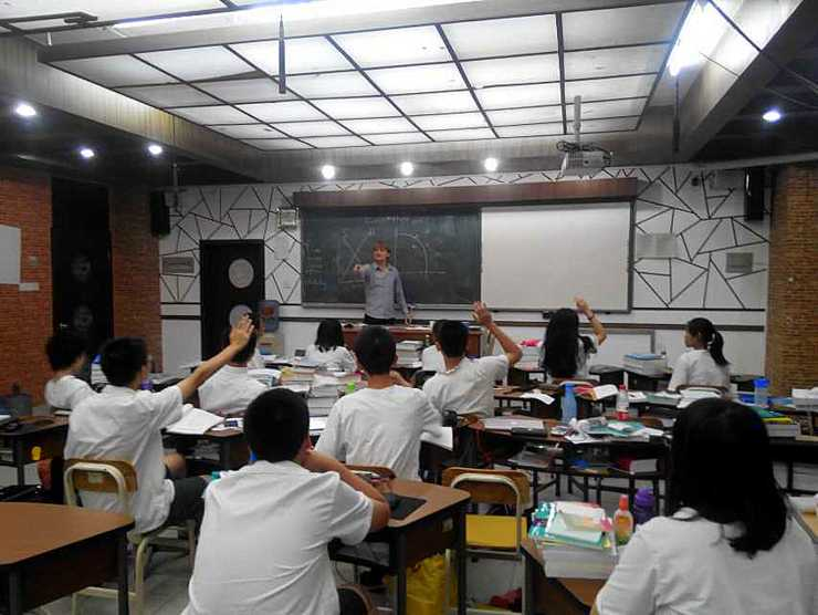 Eric in one of his many teaching jobs abroad.