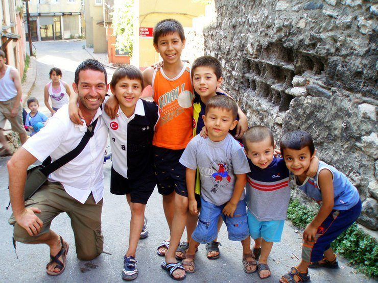 James with some young locals in a historic Istanbul, Turkey neighborhood.