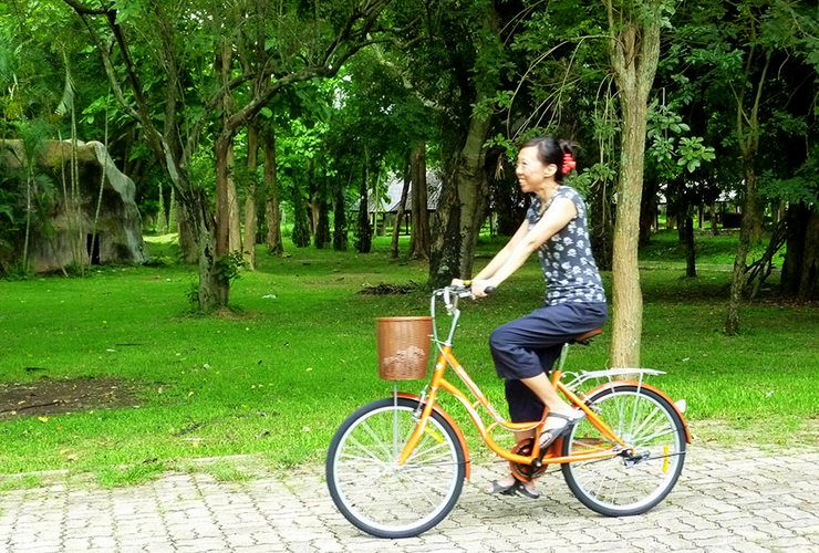 Lani on her new bicycle, Chiang Rai, Thailand, 2014.
