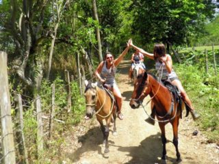 Ana Horseback riding with friends in Sanat Fe de Antioquia, Colombia.