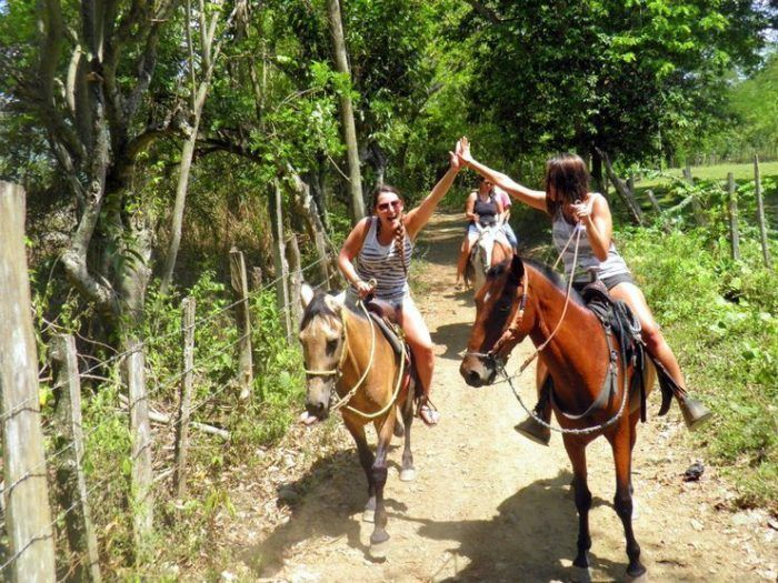 Ana Horseback riding with friends in Sanat Fe de Antioquia, Colombia.