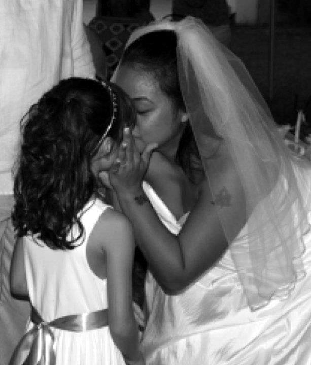 Clarissa including her daughter, Malia in her wedding ceremony, August 2011.