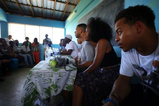 Shelah leading a talk-back in Kingston, Jamaica with actors Robert Ri'chard, Lance Gross, Raven Symone & others, June 2013.