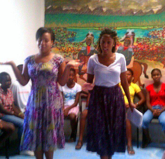Shelah (right) teaching STW students in Haiti, August 2013.