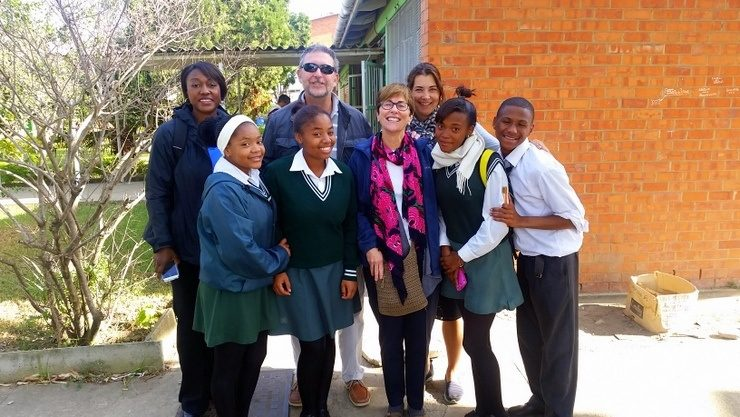 Posing with students in South Africa.