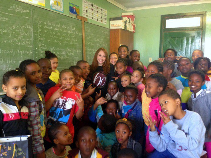 Stephanie with students in South Africa.