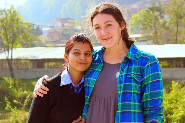 Beth and her student, Bobita, filming in the field.