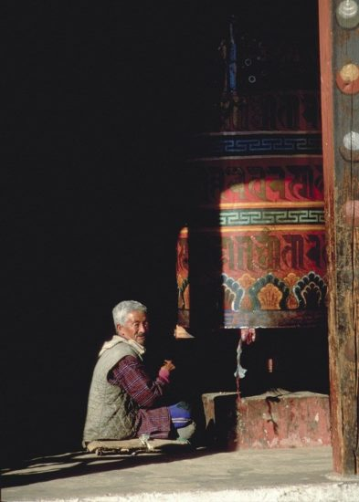 This Buddhist man spends his days spinning the colorful prayer wheel in Bhutan.