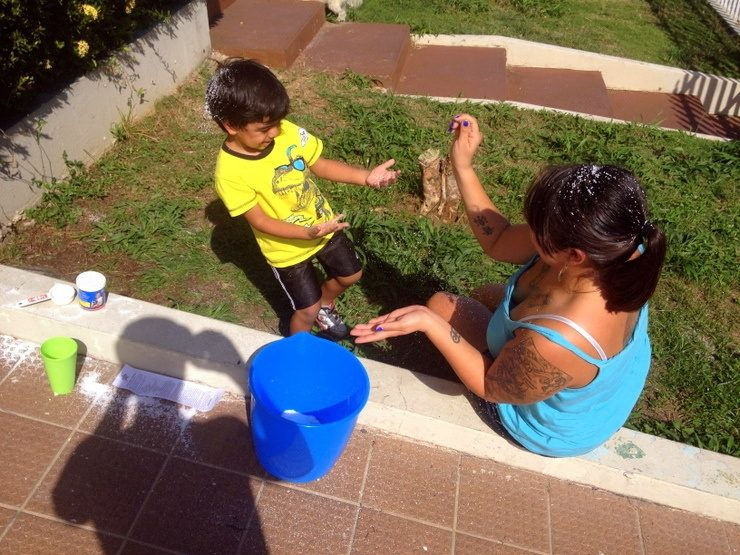 Rease in Puerto Rico, teaching her nephew, Noah, about snow (which he has never seen in real life!)