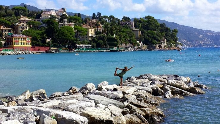 Fenesha in Santa Margherita, Italy, striking a yoga pose.