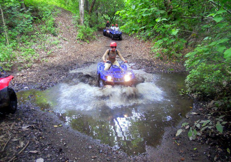 Costa Rica: Fenesha racing in the mud.