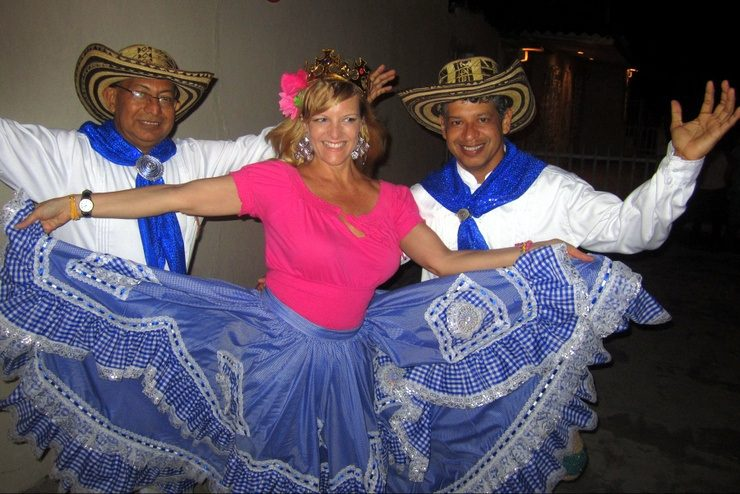 Kate wearing a traditional falda, dancing in Barranquilla, Colombia, February 2014 with two members of Guapachosa, a Cumbia group during the weekend of Guacherna, just before Carnaval begins.