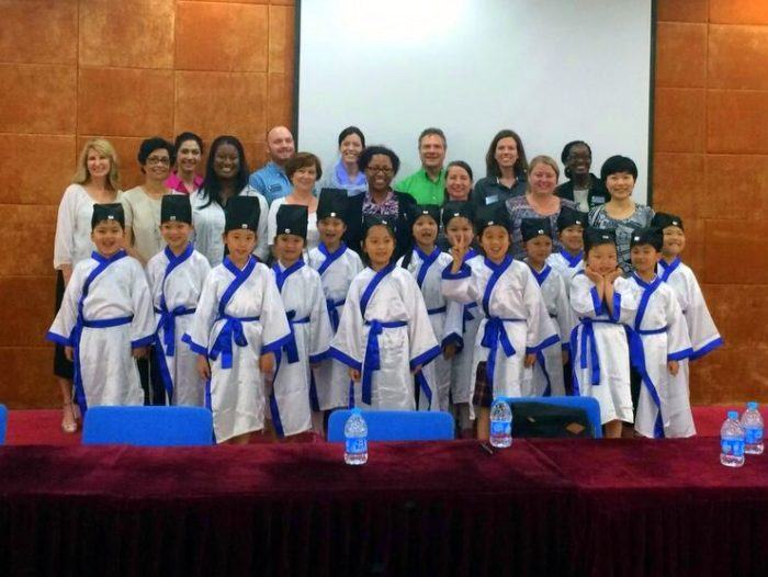 Candance and her colleagues with some of the sweet first graders from the Xu Guangqi Primary School in Shanghai, China.