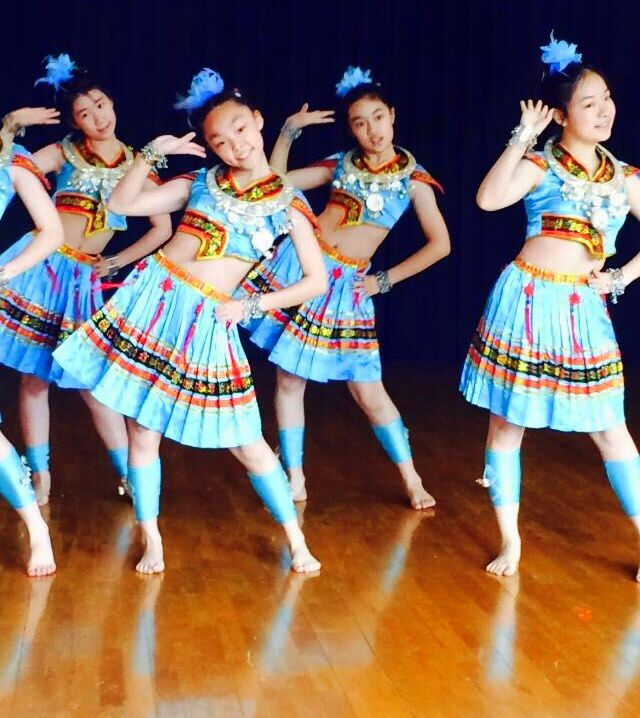 Some amazing middle school dancers in Shanghai. They were dressed in a costumed version one of the ethnic minorities in China. Beautiful!