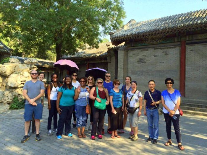 Candace and her colleagues at the Forbidden City in Beijing. She remember that it was HOT that day!