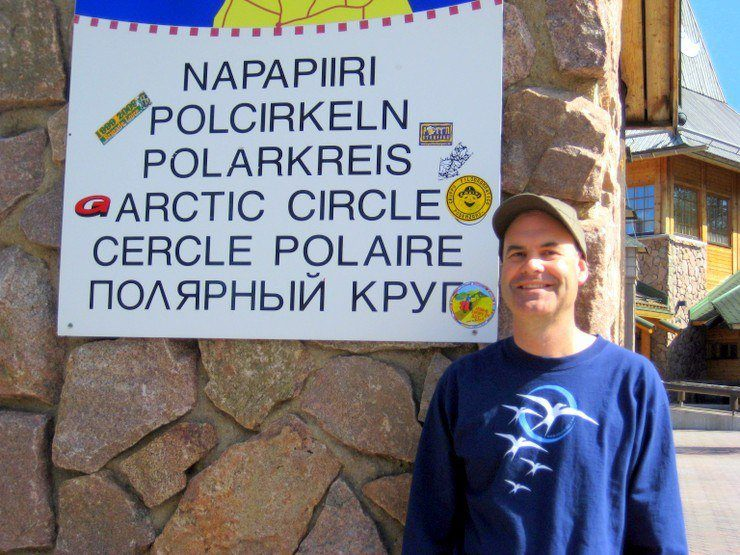 Posing at the Arctic Circle in Finland.