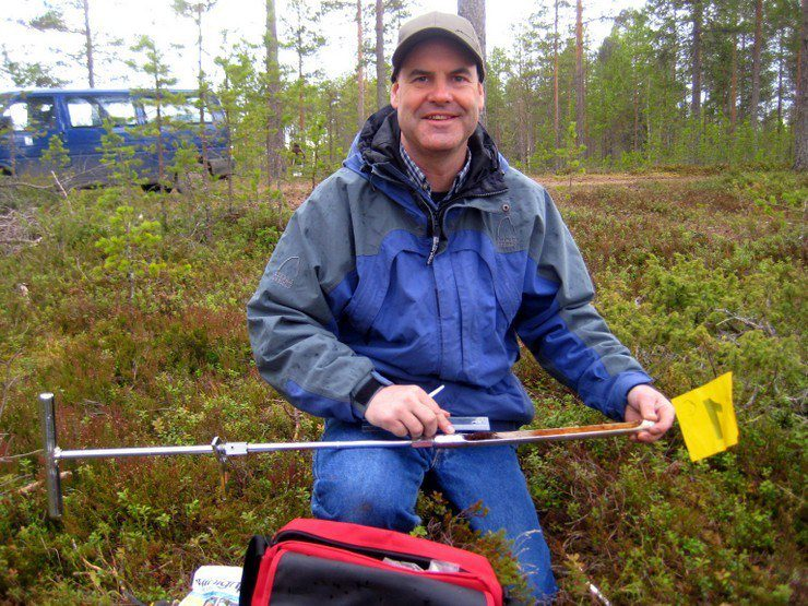 Sampling soil in Finland.