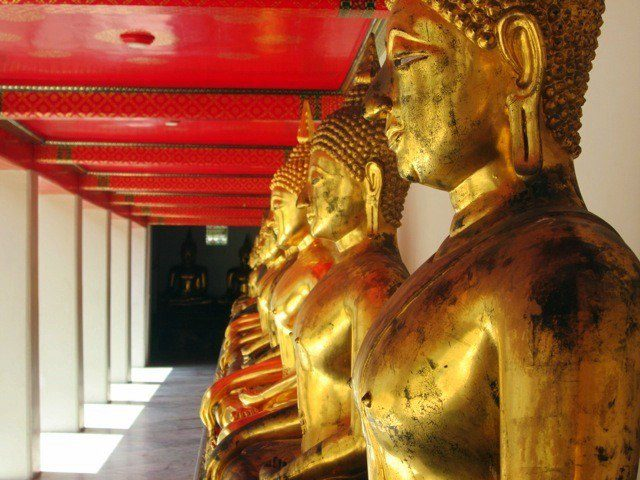 Rows of gold Buddhas at Wat Pho in Bangkok.