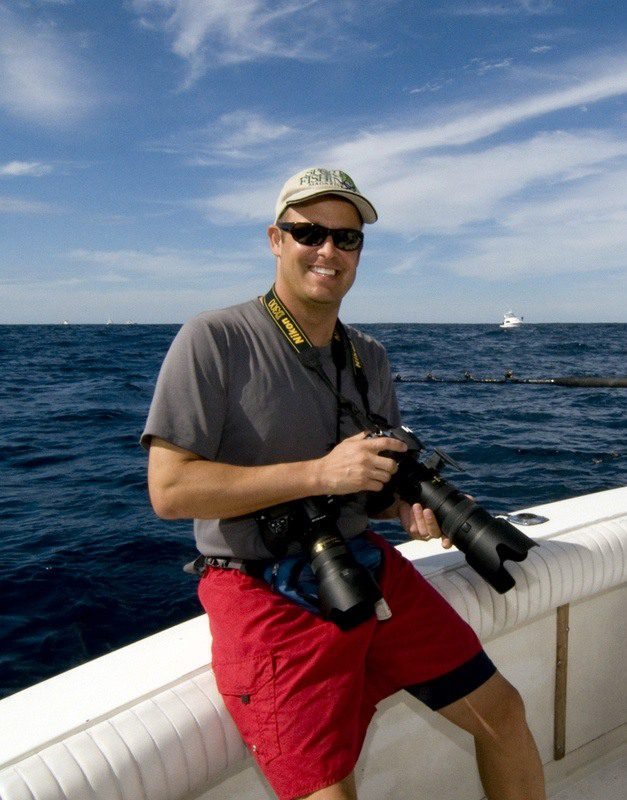 Jon with his trusty camera, ready to photograph the fish.