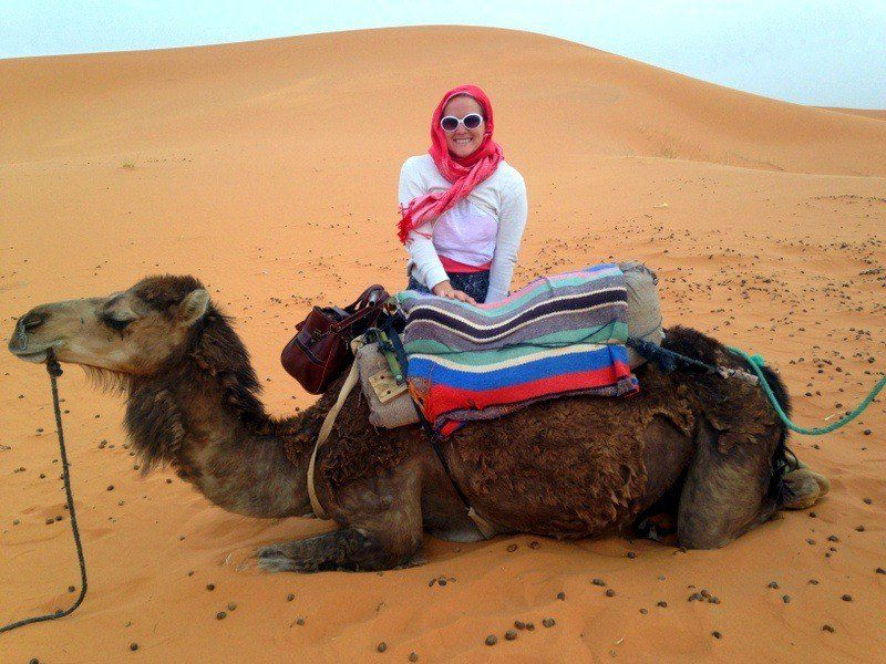 With a camel in the Sahara Desert, Morocco.