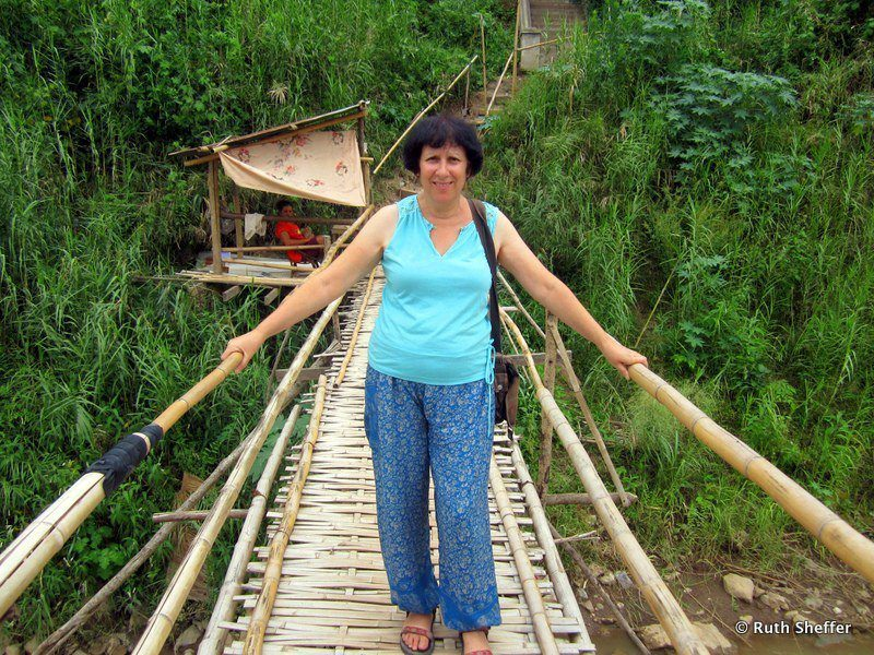Ruth on a rope bridge in Laos during her travels.