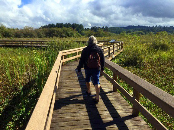 Louise walking on a board walk in Washington.