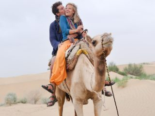 Ernie with his wife on their camel safari in the Thar Desert.