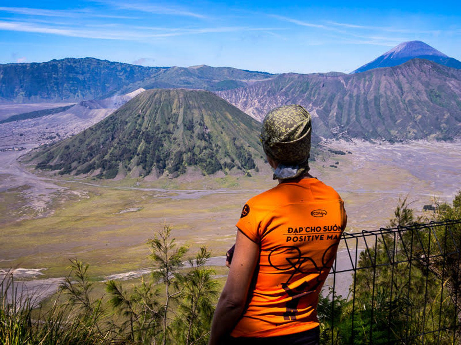 Jane takes in the beauty of Mount Bromo, Indonesia after a long, steep climb.
