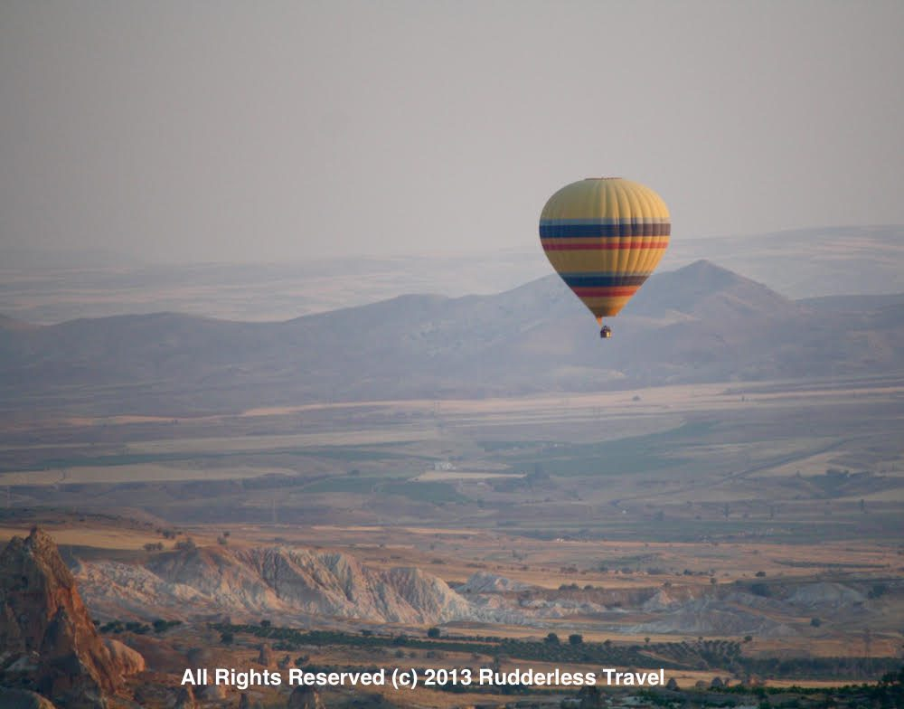 Flying in a balloon over the moon-like landscape of Cappadocia, Turkey.