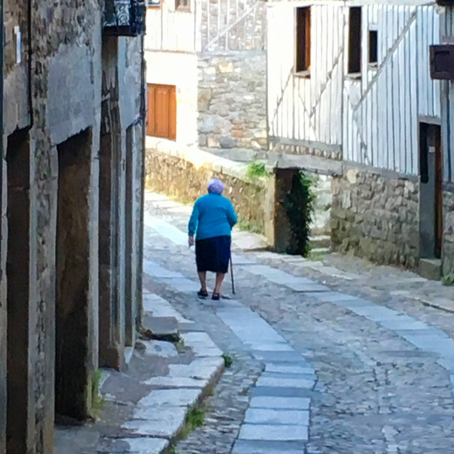 "Rita from ""Supermercado Rita"" in La Alberca. One of the many villagers seen walking early."