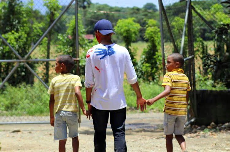 Irvin playing with local children while volunteering.