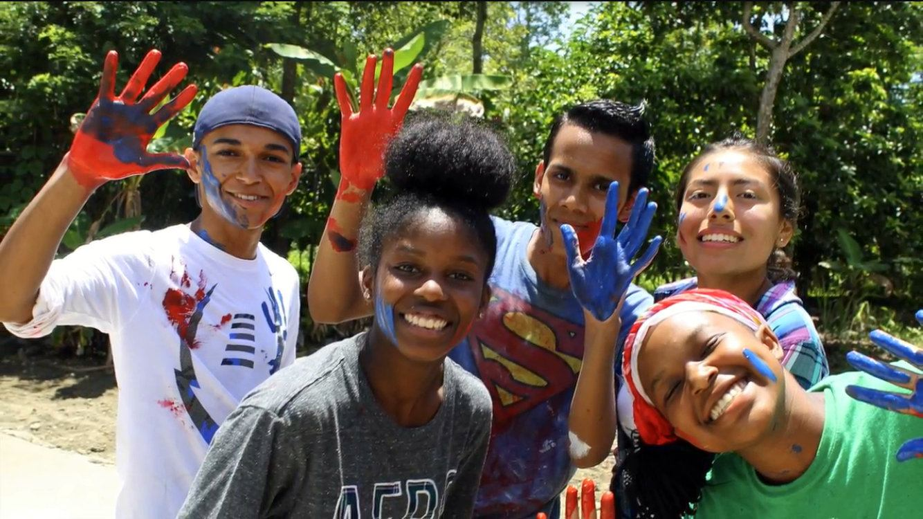 Irvin (on the left) volunteering in the Dominican Republic.
