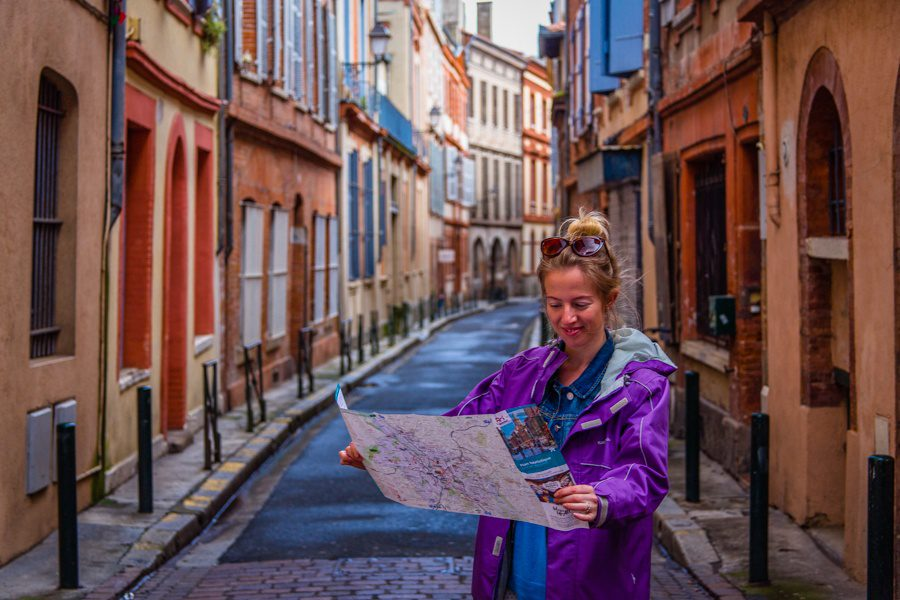Using a map to find her way around Toulouse, France.