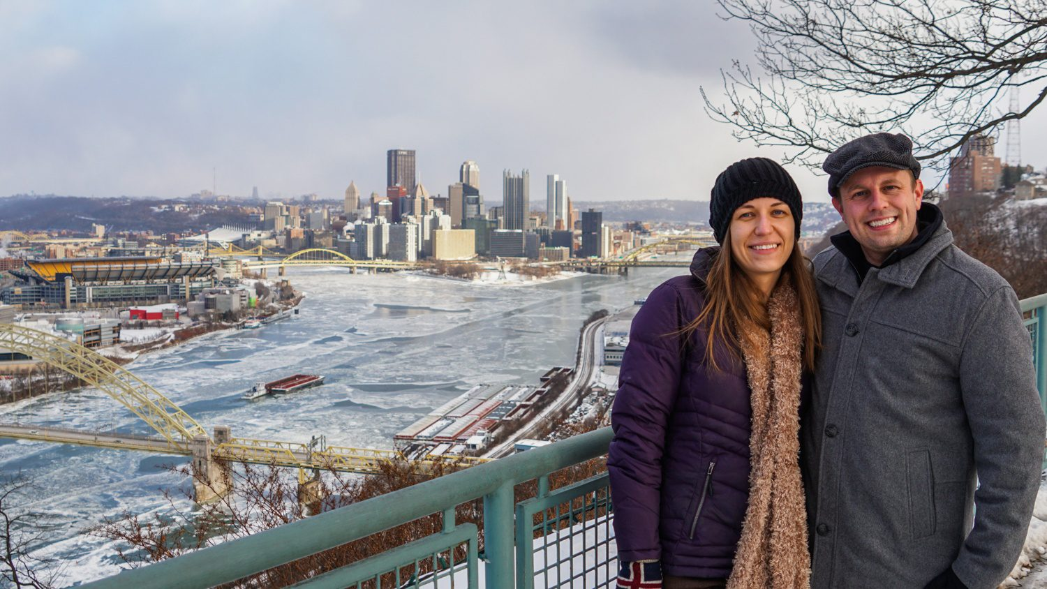 """Teaching others about your city is a beautiful kind of education! For Pittsburgh, PA, """"Discover the Burgh"""" has become a great resource for those looking to visit Pittsburgh, as well as locals looking for the best things to do around the city. Pictured: Jeremy and Angie, with Pittsburgh, PA shining below."""