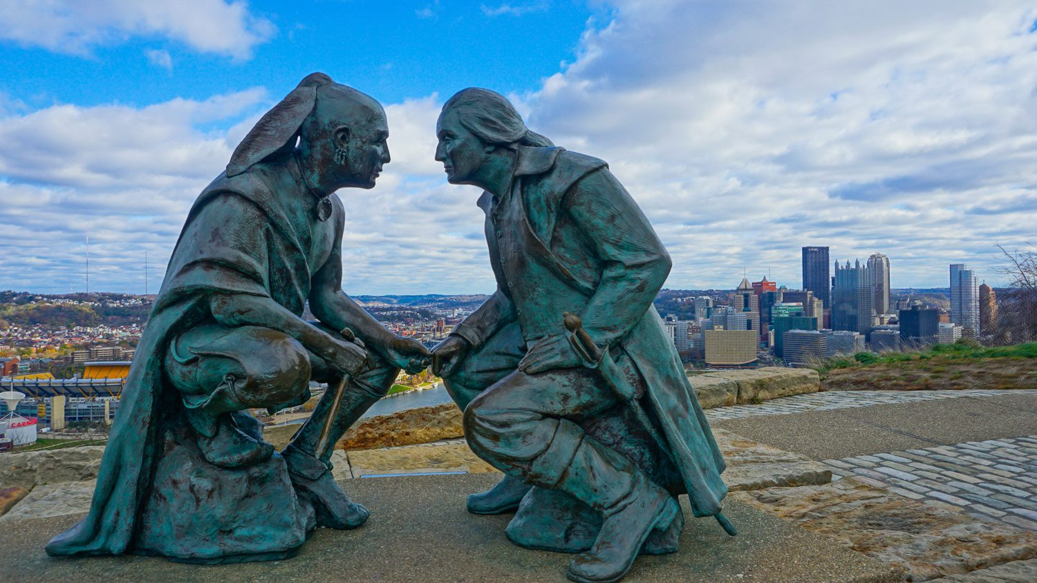"""Teaching others about your city is a beautiful kind of education! For Pittsburgh, PA, """"Discover the Burgh"""" has become a great resource for those looking to visit Pittsburgh, as well as locals looking for the best things to do around the city. Pictured: """"Point of View"""" Statue on Mount Washington overlooking the city of Pittsburgh."""