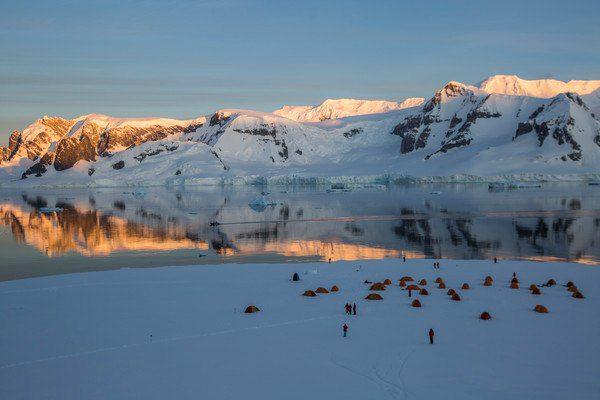 Antarctica's Ronge Island camping at sunset.