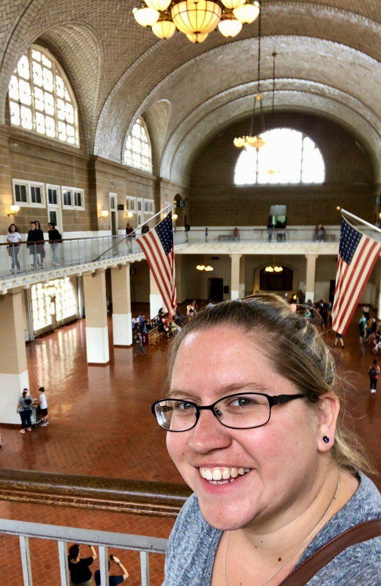 Trisha at Ellis Island, seeing where history happened.