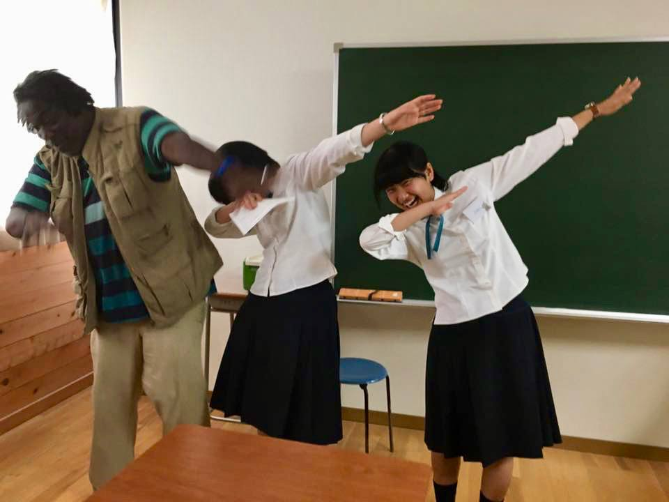 """Dunn teaching Japanese students how to do the dance move, """"The Dab."""""""