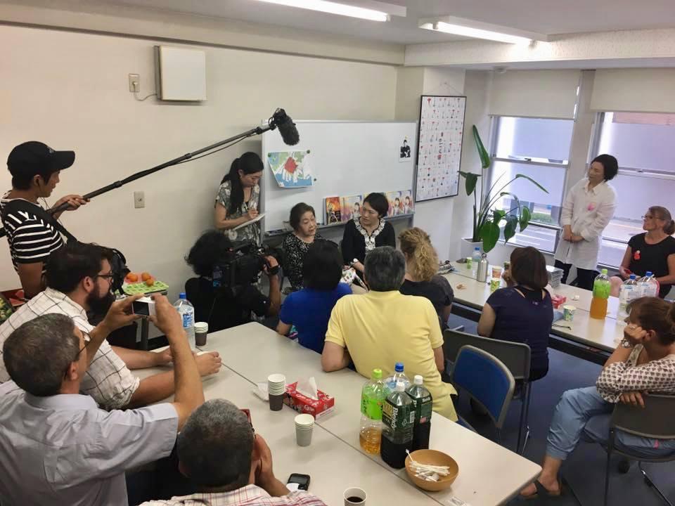 Listening to a testimony of a Hiroshima survivor (hibakusha).