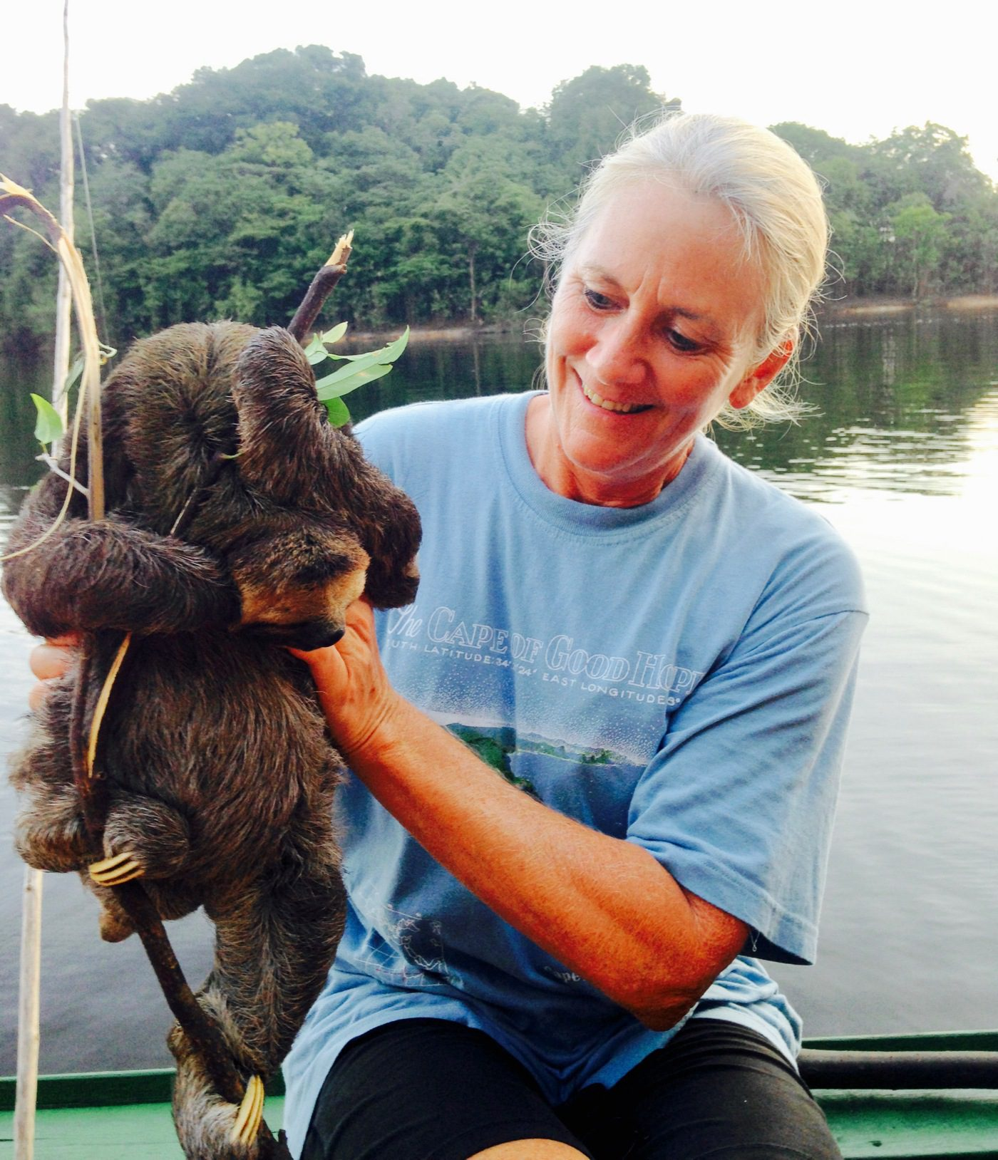 Holding a sloth in a remote village in Brazil.