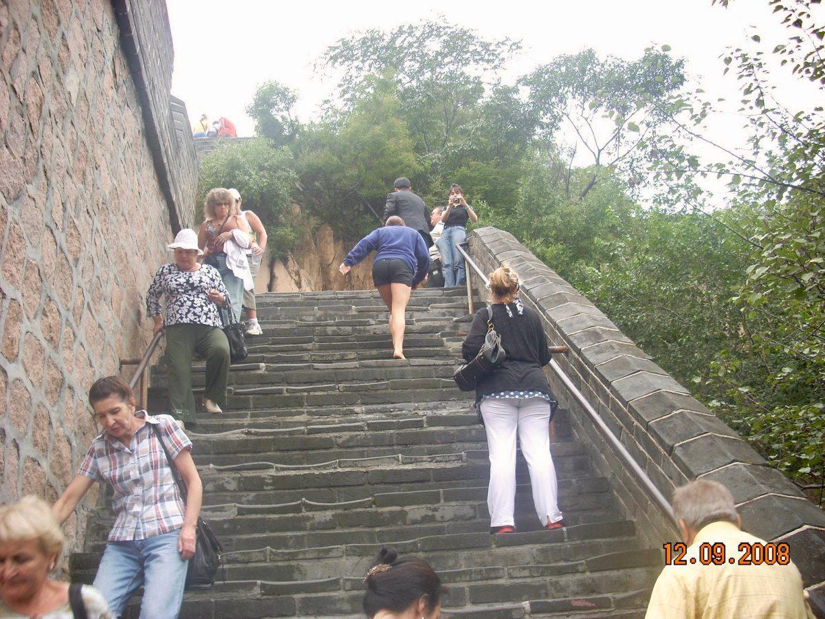 Climbing the Great Wall of China.