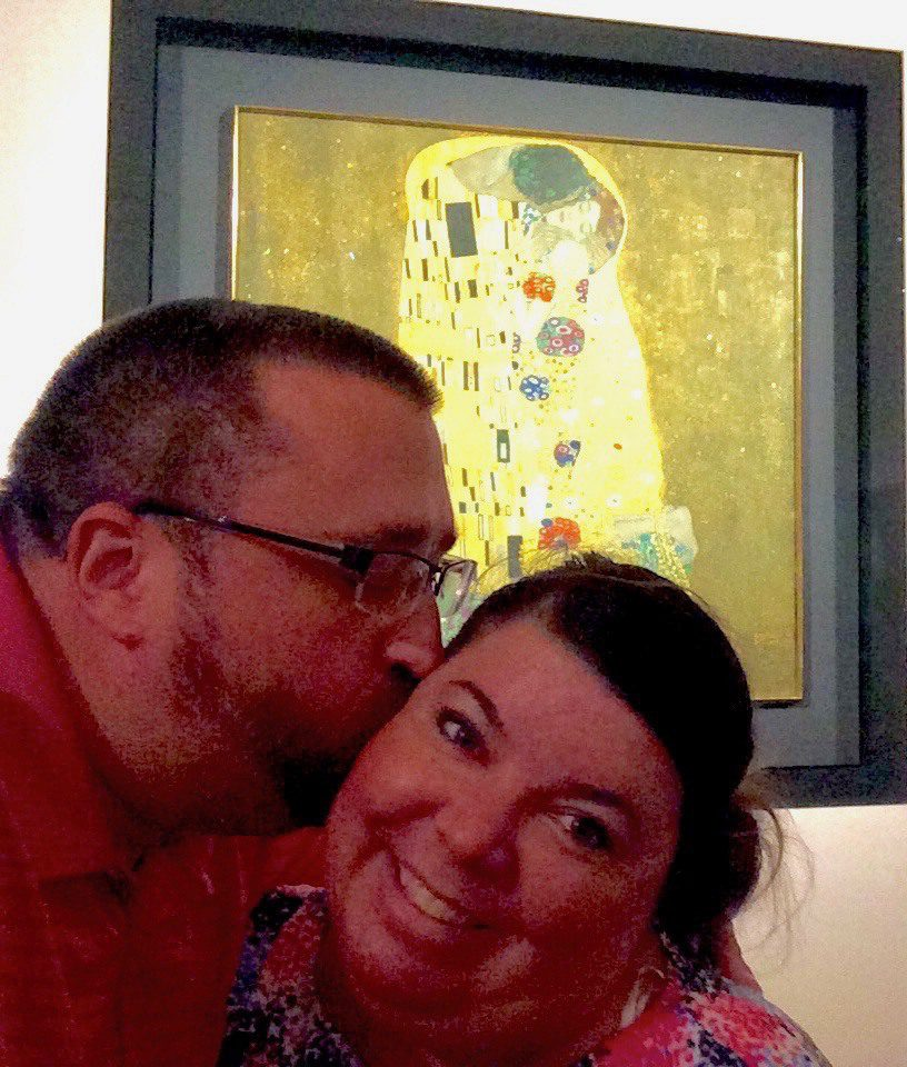"Todd and wife reenacting ""The Kiss"" by Gustav Klimt in Vienna."