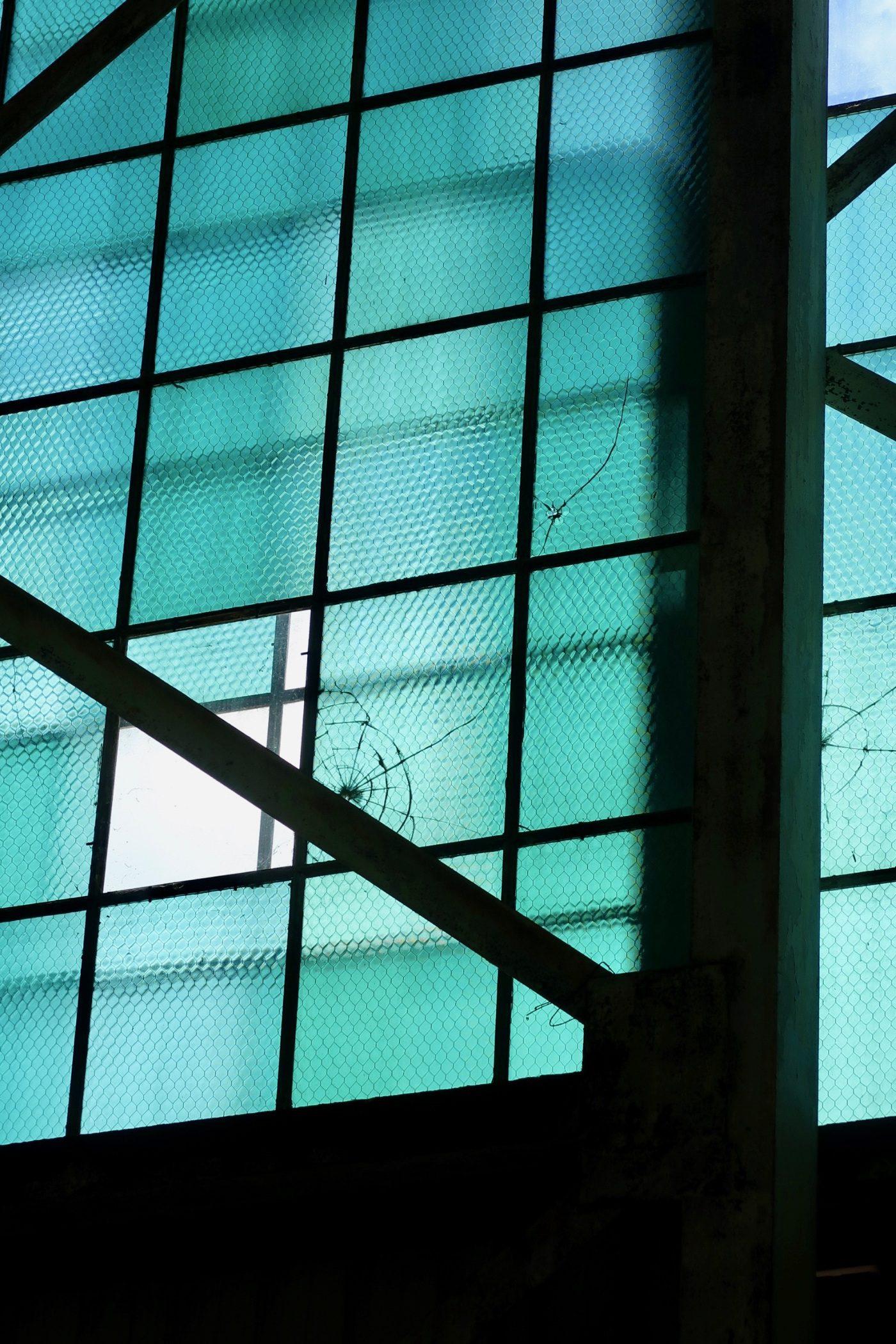 A broken window in a Pearl Harbor hanger.