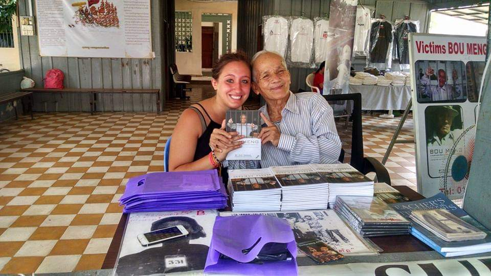 This photo was taken during a visit to the Cambodian Genocide memorial and museum. The gentleman (Bou Meng) in the photo is the Cambodian genocide survivor that Stephanie was able to meet with. She purchased his book to use in her class.